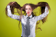 Lady and her long hair. On green background royalty free stock images