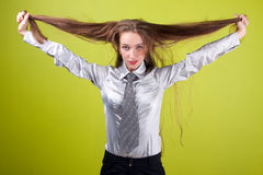 Lady and her long hair. On green background stock photography