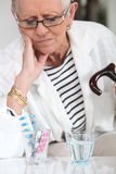Lady with her medication Royalty Free Stock Images