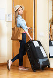 Lady with her  suitcases is ready to go Stock Photos