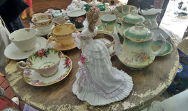 Lady and her tea set collection Stock Image