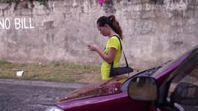 Lady her uses cellphone to communicate text messages. San Pablo City, Laguna, Philippines - April 26, 2015: lady her uses cellphone to communicate text messages stock video footage