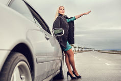 Lady in high heel shoes with broked car on the highway Stock Photography