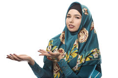 Lady in Hijab Advertising Pose Royalty Free Stock Photo