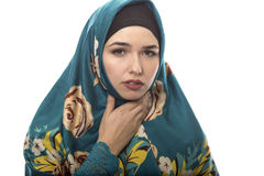 Lady in Hijab Sick with Sore Throat. Female wearing a hijab, conservative fashion for muslims, middle east and eastern european culture.  She is isolated on a Royalty Free Stock Images
