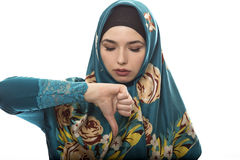 Lady in Hijab Thumbs Down Royalty Free Stock Image