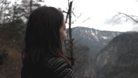 Lady hiker with backpack looking on hills and mountain river lake, girl enjoying nature panoramic landscape in trip. Relax holiday. Traveler woman exploring stock video footage