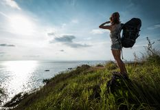 Lady hiker with backpack royalty free stock photo