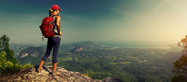 Lady hiker on the mountain royalty free stock photography