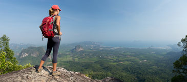 Lady hiker on the mountain stock photo
