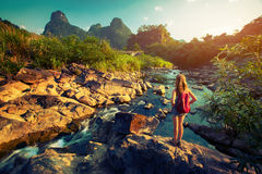 Lady hiker standing on the rock. And enjoying view of the river royalty free stock images
