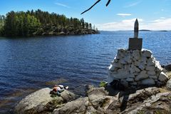 Lady hiker taking a break. And enjoying the cool water of the lake during a hot, summer day royalty free stock photo