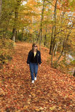 Lady Hiking An Autumn Trail Stock Image