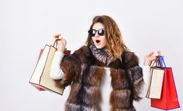Lady hold shopping bags. Discount and sale. Buy with discount on black friday. Shopping with promo code. Woman shopping. Luxury boutique. Girl wear sunglasses royalty free stock images