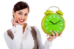 Lady holding alarm clock Stock Photography