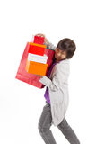 Lady holding bags and gift box with happy action, full length po Stock Image
