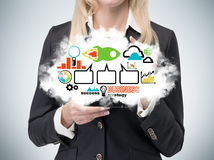 Lady is holding a cloud with the business strategy flowchart. Colourful business icons. Stock Image