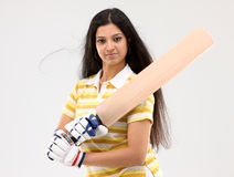 Lady holding cricket bat Royalty Free Stock Photos
