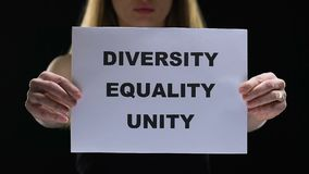 Lady holding diversity equality unity sign, struggling for female social rights. Stock footage stock video