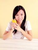 Lady holding a glass of orange juice Royalty Free Stock Image