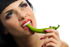 Lady holding green chilli peppers stock photo