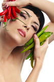Lady holding hot chilli peppers Royalty Free Stock Images
