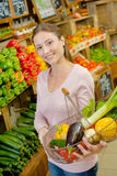 Lady holding metal basket fruit and vegetables Stock Photo
