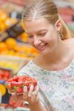 Lady holding punnet strawberries Royalty Free Stock Image