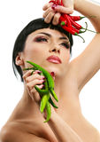 Lady holding rhot chilli peppers Royalty Free Stock Photography