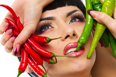Lady holding rhot chilli peppers Royalty Free Stock Photos