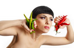 Lady holding rhot chilli peppers Royalty Free Stock Photo