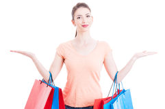 Lady holding shopping bags showing blank with both hands Stock Image
