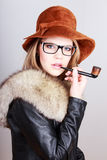 Lady holding a smoking pipe Stock Images