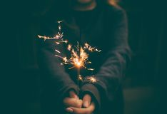 Lady Holding Sparkler Stock Images