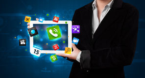 Lady holding a tablet with modern colorful apps and icons Stock Photo