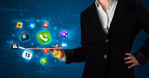 Lady holding a tablet with modern colorful apps and icons Royalty Free Stock Photo