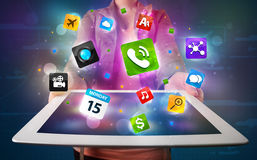 Lady holding a tablet with modern colorful apps and icons Royalty Free Stock Images