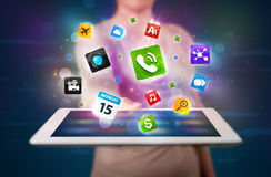 Lady holding a tablet with modern colorful apps and icons Stock Photos