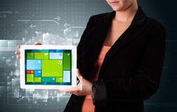 Lady holding tablet with modern software operational system Stock Photography
