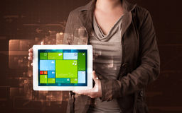 Lady holding tablet with modern software operational system Royalty Free Stock Photo