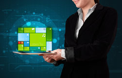 Lady holding tablet with modern software operational system Royalty Free Stock Photography
