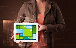 Lady holding tablet with modern software Stock Photography