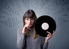 Lady holding vinyl record Royalty Free Stock Image