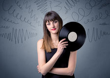 Lady holding vinyl record Stock Images