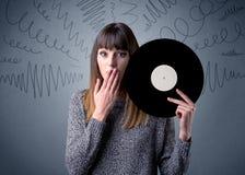 Lady holding vinyl record Royalty Free Stock Photo