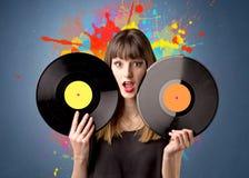 Lady holding vinyl record Stock Photo