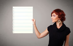 Lady holding white paper copy space with diagonal lines Stock Photo