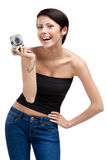 Lady holds amateur hand-held camera. Lady holds amateur hand-held silver camera, isolated on white stock photos