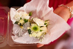 Lady holds a box with boutonniere made on roses in her arms Stock Images