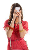 Lady holds a cell phone. Royalty Free Stock Images
